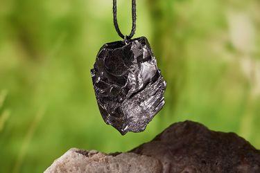 A pendant with elite shungite stone 5-6 g (0,17-0,21 oz)